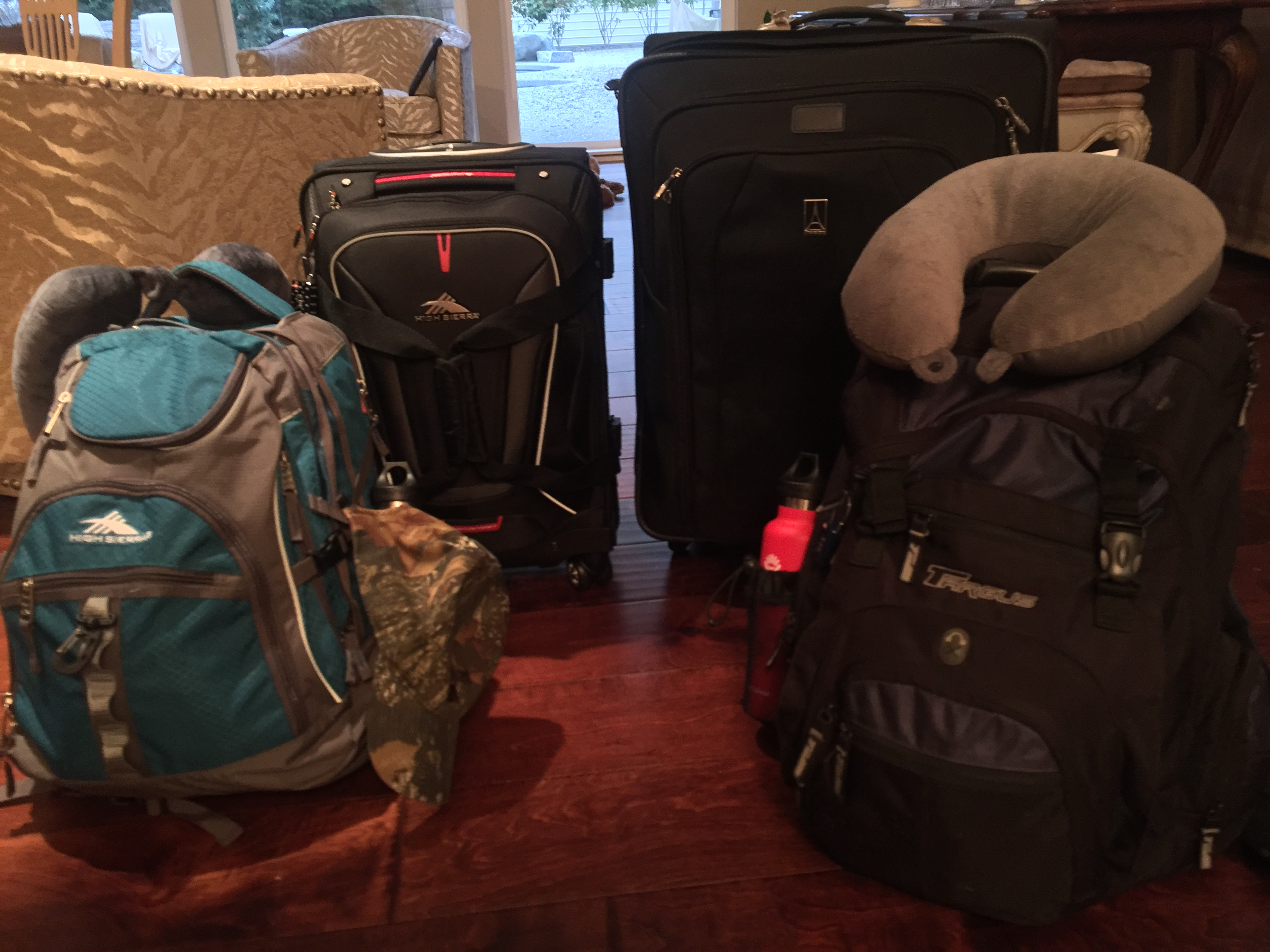 2 suitcases and 2 back packs for a year