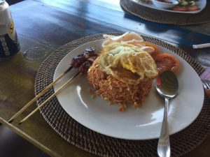 bali rice and egg with chicken skewers